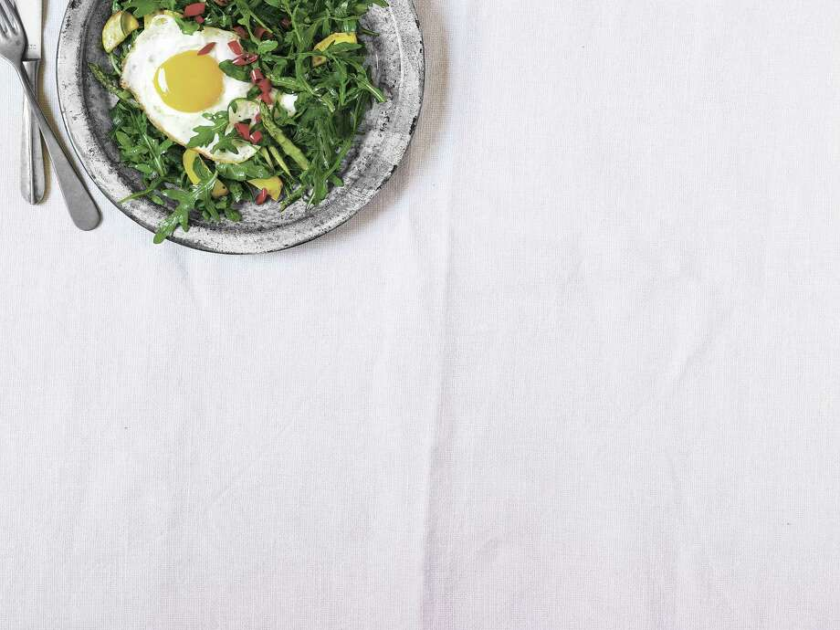 Country Living recipe for Wild Arugula with Summer Squash, Asparagus, and a Fried Egg. Photo: Ellen Silverman