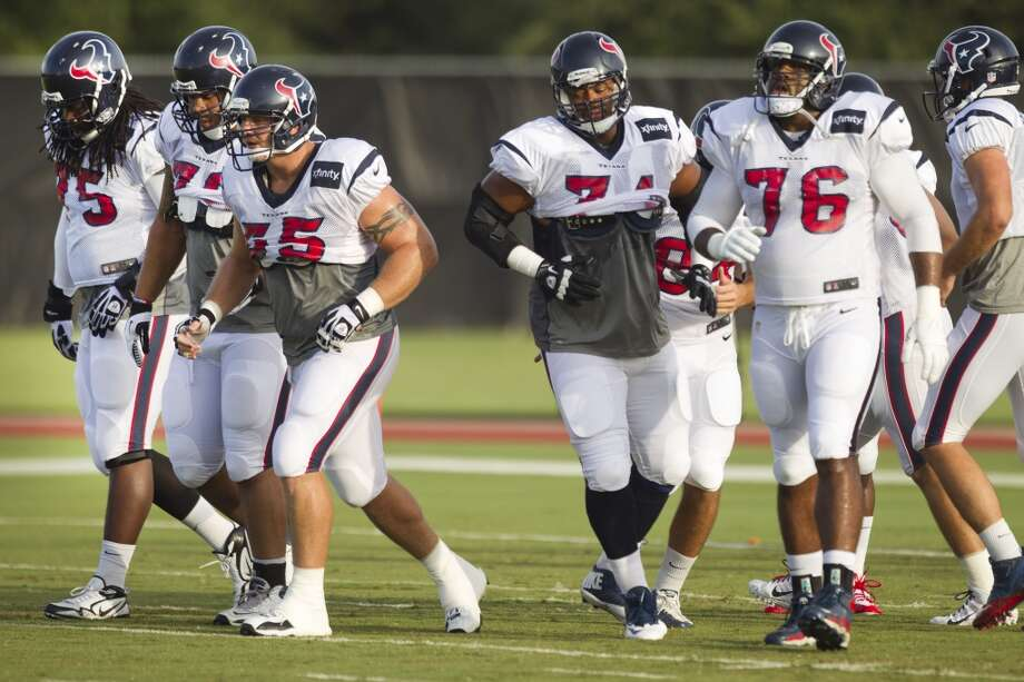 Offensive linemen, from left, tackle Derek Newton (75), guard Brandon Brooks (79), center Chris Myers (55), guard Wade Smith (74) and tackle Duane Brown (76) run to the line as they break the huddle. Photo: Brett Coomer, Chronicle