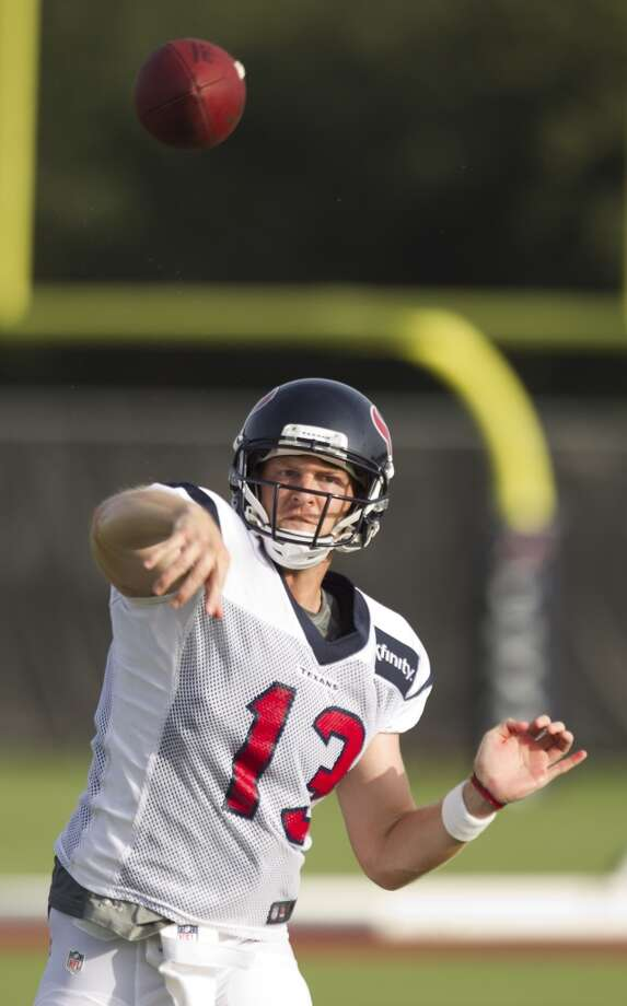 Quarterback T.J. Yates throws a pass during Texans training camp. Photo: Brett Coomer, Chronicle