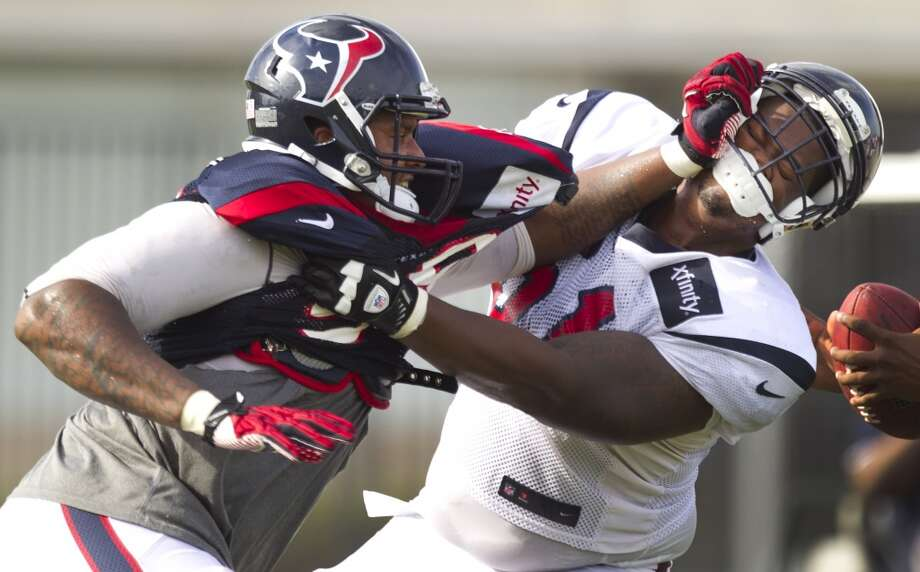 Defensive end Keith Browner (98) battles with guard Bryan Collins (61). Photo: Brett Coomer, Chronicle