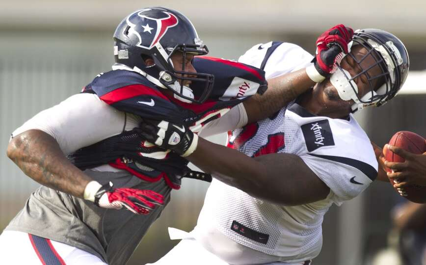 Defensive end Keith Browner (98) battles with guard Bryan Collins (61).