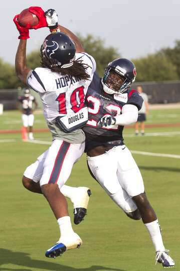 Wide receiver DeAndre Hopkins (10) goes up to pull down a reception with defensive back Roc Carmicha