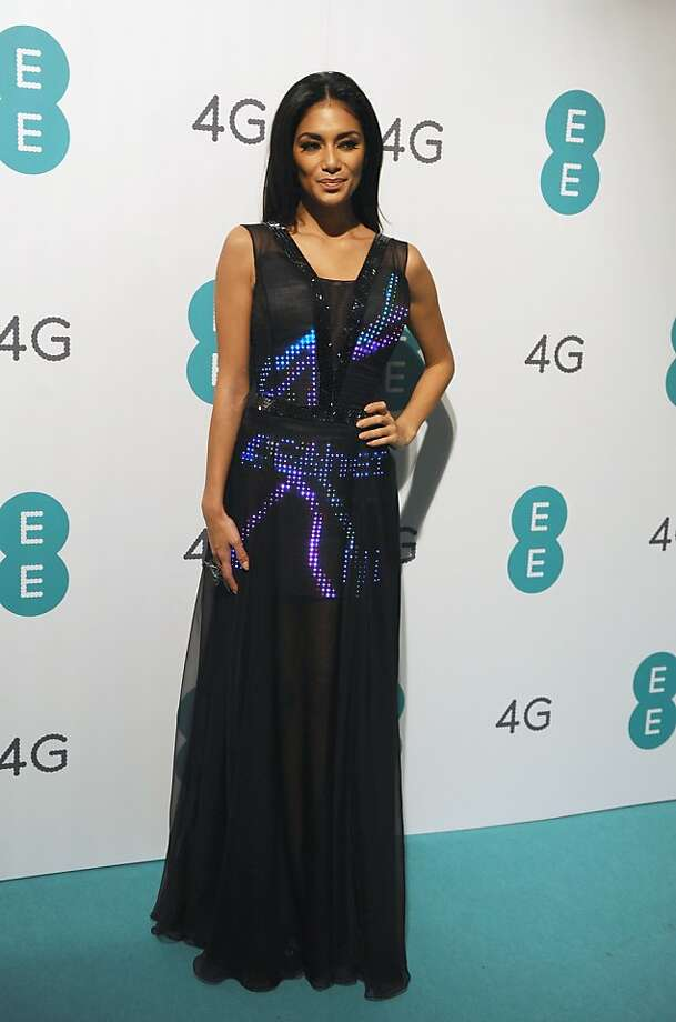 Above right, Nicole Scherzinger wears a Twitter dress at the launch party for EE, Britain's first 4G mobile network, in November in London. The gown had 2,000 LED lights that displayed incoming tweets in real time. Top, a shoe with GPS capabilities to point the way home by designer Dominic Wilcox. Photo: Ferdaus Shamim, WireImage