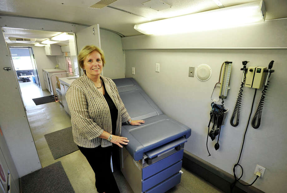 Karen Gottlieb, AmeriCares free clinic executive director, poses inside an exam room within the organization's mobile clinic outside the AmeriCares headquarters in Stamford on Tuesday, July 30, 2013. This fall AmeriCares will be sending the mobile clinic to three Stamford locations per week to provide free primary health care to those without insurance until the organization can find a permanent location. Photo: Jason Rearick / Stamford Advocate