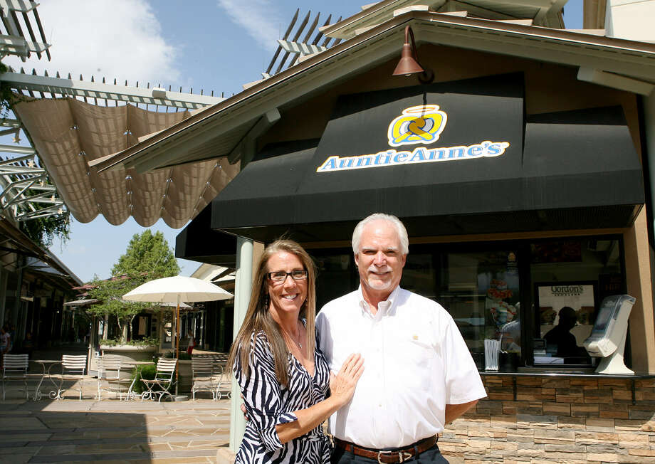 Lisa Fullerton and her husband, Jim Fullerton, at the Auntie Anne's Pretzels kiosk at the Shops at La Cantera. The couple said they work well together. Lisa Fullerton opened her first Auntie Anne's in the North Star Mall in 2000. Photo: Cynthia Esparza / For The San Antonio Express-News