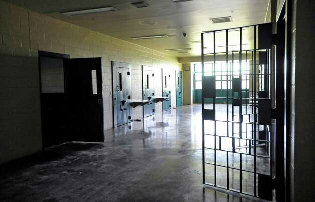 Inside the security building, these doors closed on cells that were used for letting kids just cool off, or to be held overnight in.   The Al Price Juvenile Correctional Center on Highway 69 in Nederland has been closed for two years.  But it is still being maintained by two caretakers and Jefferson County will take custody of the facility in January of 2014.    Dave Ryan/The Enterprise Photo: Dave Ryan