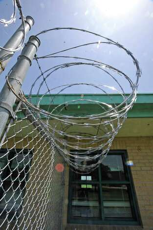 The administration building, as with several of the buildings, had plenty of razor wire hanging from the fencing. The Al Price Juvenile Correctional Center on Highway 69 in Nederland has been closed for two years.  But it is still being maintained by two caretakers and Jefferson County will take custody of the facility in January of 2014.    Dave Ryan/The Enterprise Photo: Dave Ryan