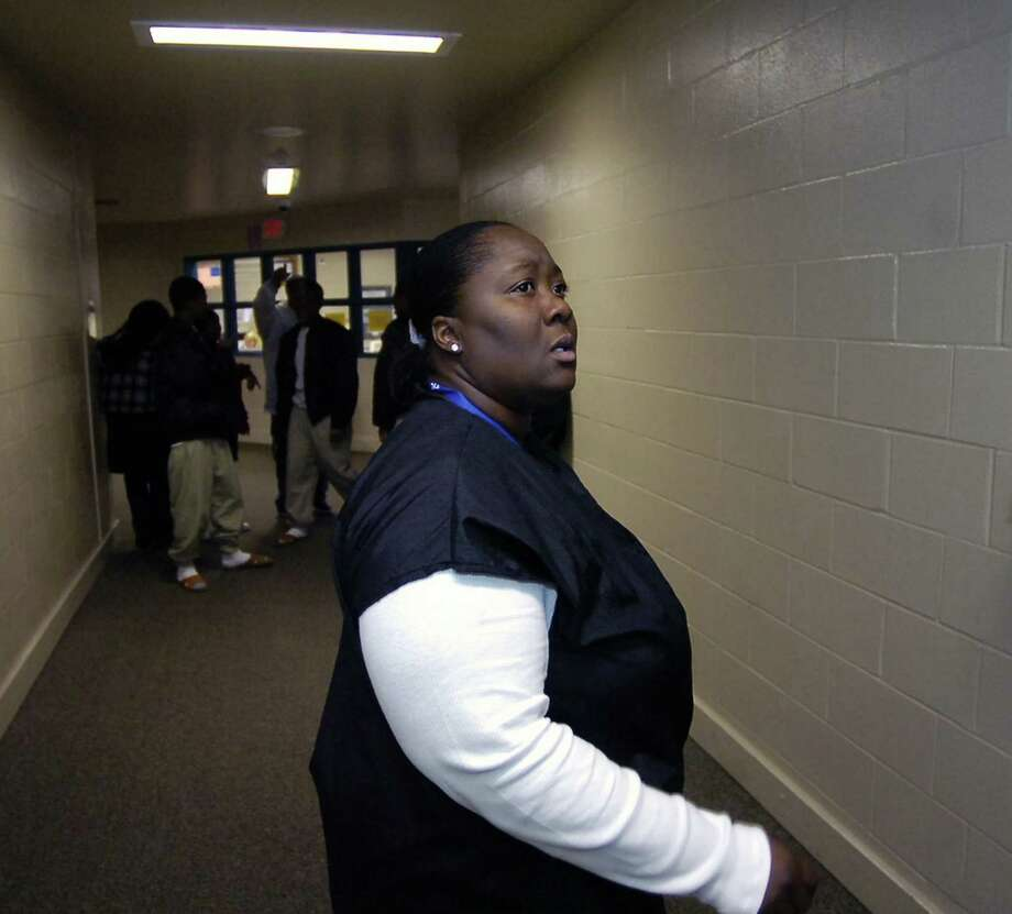 Juvenile  Corrections Officer Rhonda Ford watches the hall and the students in it as they move during a class change inside Al Price High School. Dave Ryan/The Enterprise Photo: Dave Ryan / Beaumont
