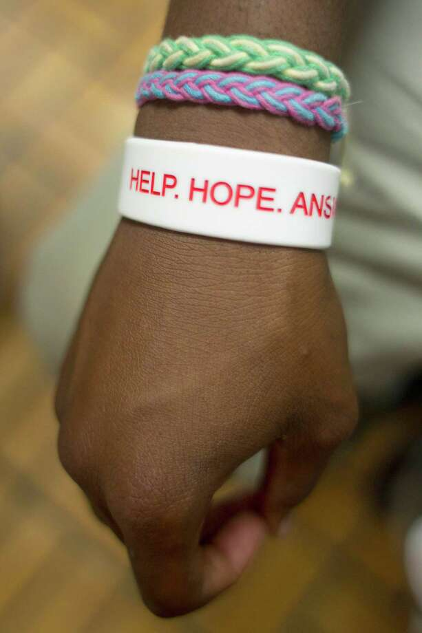 "Angelo, 18, wears a wrist band that reads ""Help, Hope, Answers"" at Covenant HouseTuesday, July 30, 2013, in Houston. Angelo went to the Covenant House after having personal issues with his father. He left home and found himself with no where else to go. ""This place is all of what you make of it,"" Angelo said. ""I've had my issues but I'm getting them straight."" Photo: Johnny Hanson, Houston Chronicle / © 2013  Houston Chronicle"