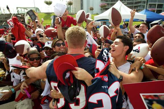 If defensive lineman J.J. Watt is game, the fans are in favor of a group hug Tuesday at the Texans' first open practice of training camp.