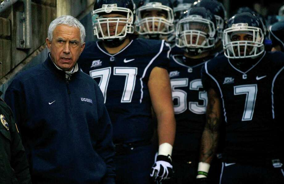 EAST HARTFORD, CT - DECEMBER 01: Head coach Paul Pasqualoni of the Connecticut Huskies awaits to go onto the field with his team prior to the game against the Cincinnati Bearcats at Rentschler Field on December 1, 2012 in East Hartford, Connecticut. Photo: Jared Wickerham, Getty Images / 2012 Getty Images