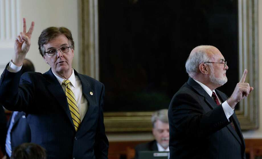 Lt. Gov. Dan Patrick, left, and Sen. Robert Nichols, R-Jacksonville, both support dedicating a portion of vehicle sales taxes for highway improvements. The photo is from 2013, when Patrick was a state senator from Houston. Photo: Eric Gay, Associated Press / AP