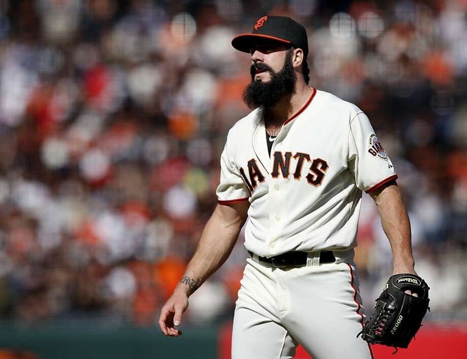 Giants closer Brian Wilson watches as Atlanta players cross home plate in the tenth inning Sunday, April 24, 2011. Photo: Brant Ward, The Chronicle