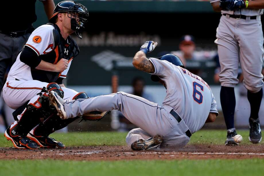 Astros shortstop Jonathan Villar steals home during the third inning against the Orioles. Photo: Patrick Smith, Getty Images