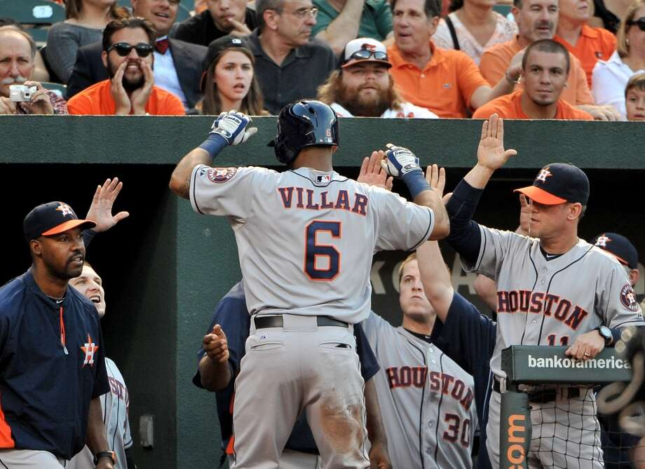Astros' shortstop Jonathan Villar is greeted by his teammates after he stole home against Orioles' pitcher Wei-Yin Chen during the third inning. Photo: Gene Sweeney Jr., Baltimore Sun/MCT