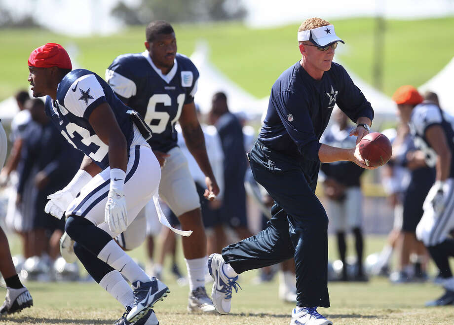 Head coach Jason Garrett works out with the team during the afternoon session of the 2013 Dallas Cowboys training camp on Tuesday, July 30, 2013 in Oxnard. Photo: Kin Man Hui, San Antonio Express-News / ©2013 San Antonio Express-News