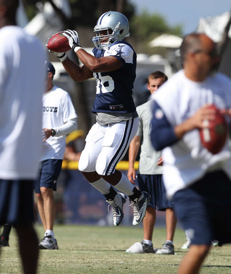 Linebacker Brandon Magee (46) catches a pass during the afternoon session of the 2013 Dallas Cowboys training camp on Tuesday, July 30, 2013 in Oxnard. Photo: Kin Man Hui, San Antonio Express-News / ©2013 San Antonio Express-News