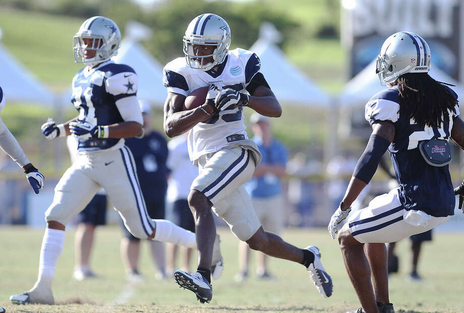 Receiver Jared Green (85) runs after a catch during the afternoon session of the 2013 Dallas Cowboys training camp on Tuesday, July 30, 2013 in Oxnard. Photo: Kin Man Hui, San Antonio Express-News / ©2013 San Antonio Express-News