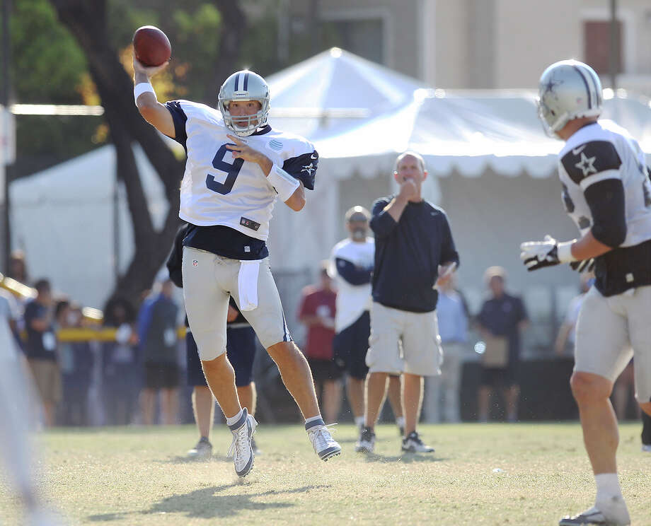 Quarterback Tony Romo (09) throws a pass during the afternoon session of the 2013 Dallas Cowboys training camp on Tuesday, July 30, 2013 in Oxnard. Photo: Kin Man Hui, San Antonio Express-News / ©2013 San Antonio Express-News