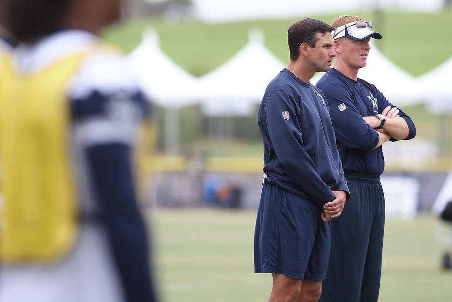 Head coach Jason Garrett (right) and wide receivers coach Derek Dooley oversee practice during the morning session of the 2013 Dallas Cowboys training camp on Tuesday, July 30, 2013 in Oxnard. Photo: Kin Man Hui, San Antonio Express-News / ©2013 San Antonio Express-News