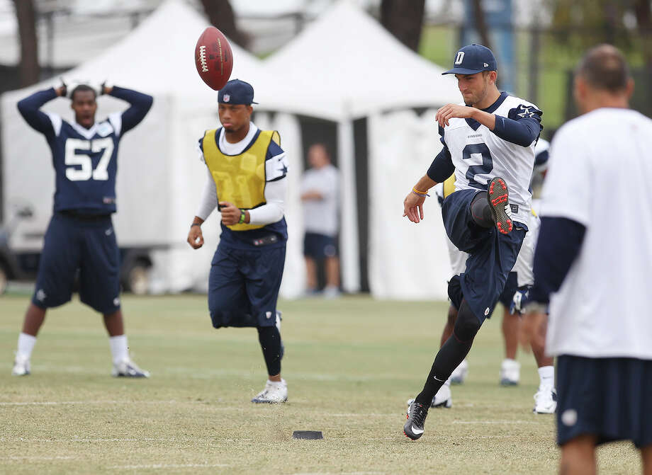 Kicker Spencer Benton works special teams drills during the morning session of the 2013 Dallas Cowboys training camp on Tuesday, July 30, 2013 in Oxnard. Photo: Kin Man Hui, San Antonio Express-News / ©2013 San Antonio Express-News
