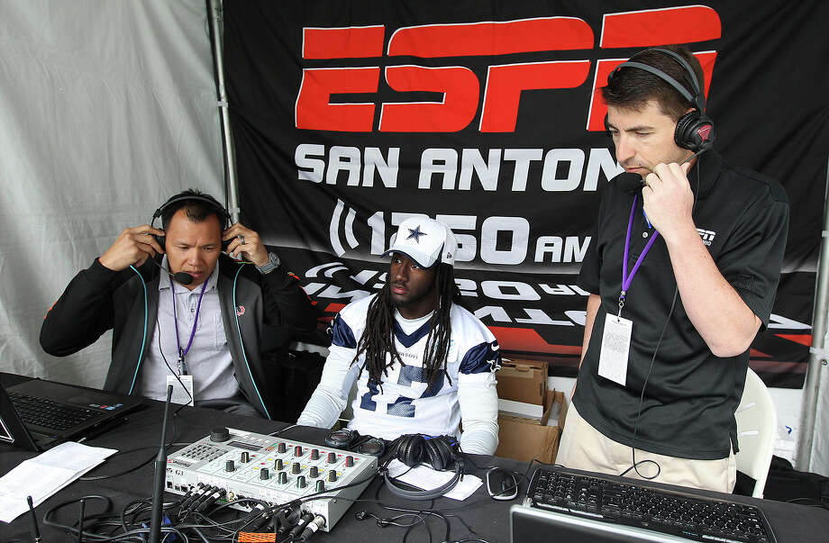 Former Cowboy and current sports radio co-host Dat Nguyen (left) and co-host Jason Minnix (right) prepare to interview receiver Dwayne Harris after the morning session of the 2013 Dallas Cowboys training camp on Tuesday, July 30, 2013 in Oxnard. Photo: Kin Man Hui, San Antonio Express-News / ©2013 San Antonio Express-News