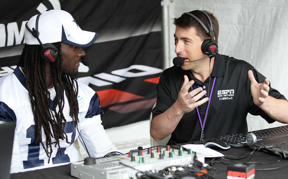 Sports radio host Jason Minnix (right) interviews receiver Dwayne Harris after the morning session of the 2013 Dallas Cowboys training camp on Tuesday, July 30, 2013 in Oxnard. Photo: Kin Man Hui, San Antonio Express-News / ©2013 San Antonio Express-News
