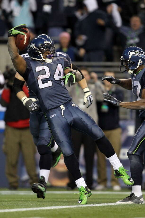 2011: Marshawn Lynch's 'Beast Quake' run upsets SaintsThe 2010 Seahawks went just 7-9 in the regular season, yet in a weak NFC West it was just enough to earn them a playoff berth -- the first NFL team to do so with a losing record. On Jan. 8, 2011, the Seahawks hosted the New Orleans Saints at what was then called Qwest Field for a wild-card playoff game no one expected Seattle to win. After all, the Saints were defending Super Bowl champs and the Seahawks were, well, a losing team. Seattle fought hard and took a narrow 34-30 lead into the final 9 minutes of the game. Then, with 3:38 to go, quarterback Matt Hasselbeck handed the ball off to newcomer running back Marshawn ''Beast Mode'' Lynch, who broke at least a half-dozen tackles on his now-famous 67-yard touchdown run. The Seahawks won 41-36, and the moment has become known in Seattle as the ''Beast Quake'' run; the 12th Man went so wild, their reaction was picked up by a nearby seismology sensor. Photo: Jonathan Ferrey, Getty Images / 2011 Getty Images