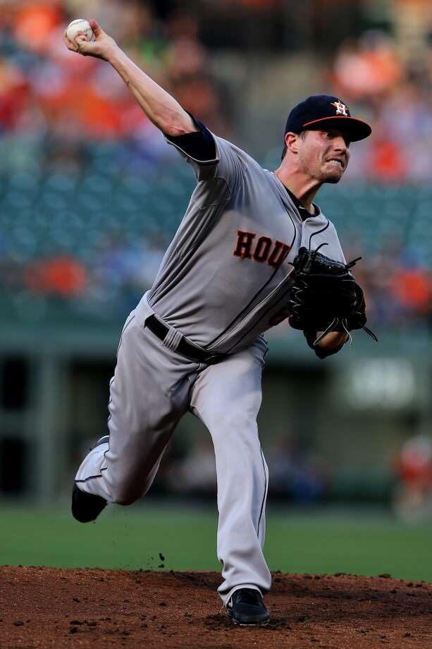 Lucas Harrell of the Astros delivers a pitch to the Orioles. Photo: Patrick Smith, Getty Images
