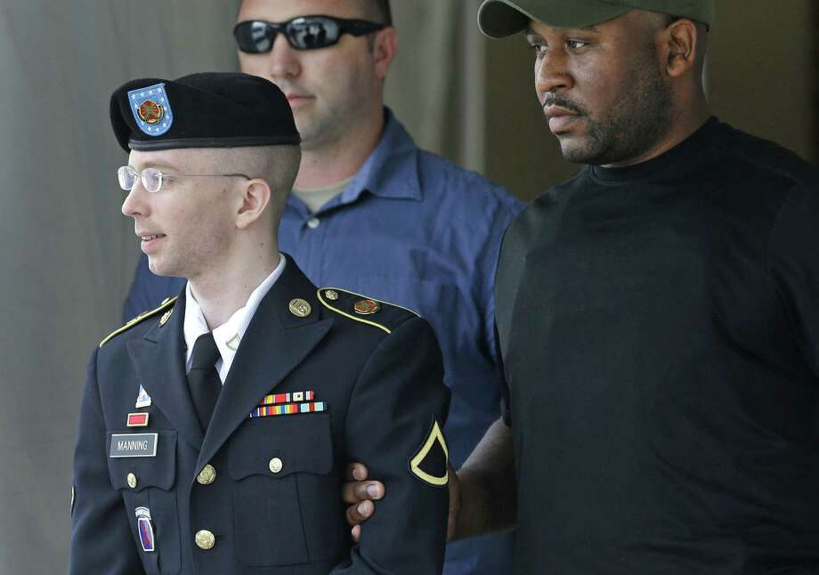 Army Pfc. Bradley Manning is escorted out of a courthouse in Fort Meade, Md., after receiving a verdict in his court-martial. He was acquitted of aiding the enemy, his most serious charge. Photo: Patrick Semansky / Associated Press