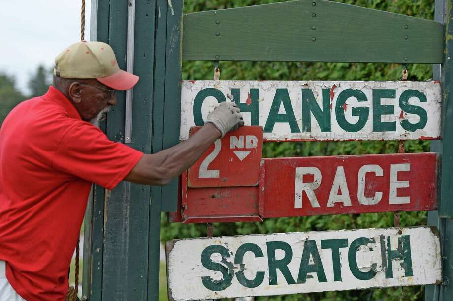 Melvin White makes changes to the tote board Monday, July 28, 2013, at Saratoga Race Course in Saratoga Springs, N.Y.  (Skip Dickstein/Times Union) Photo: SKIP DICKSTEIN