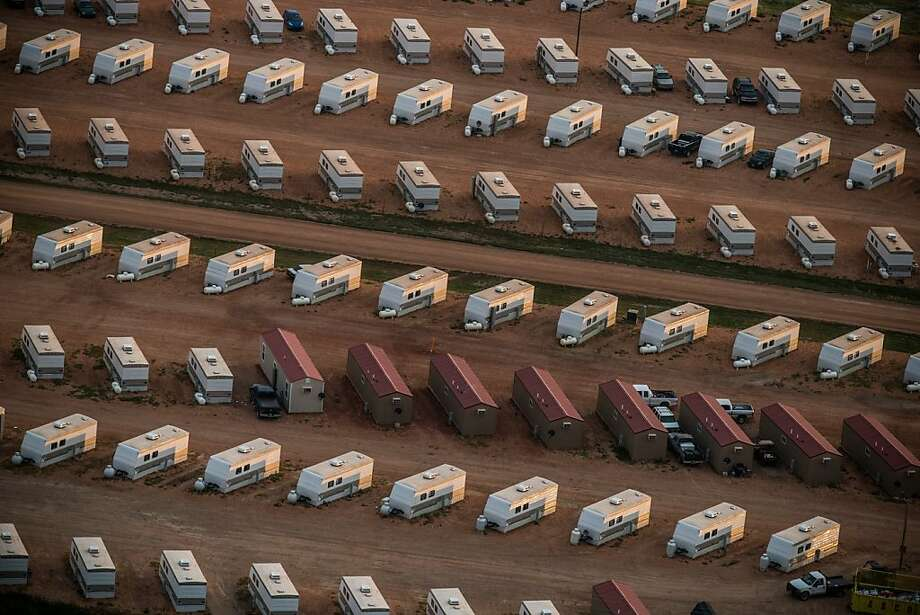 WATFORD CITY, ND - JULY 30:  A trailer park occupied mostly by oil workers is seen in an aerial view in the early morning hours of July 30, 2013 near Watford City, North Dakota. North Dakota has seen a boom in oil production thanks to new drilling techniques including horizontal drilling and hydraulic fracturing.  (Photo by Andrew Burton/Getty Images) Photo: Andrew Burton, Getty Images