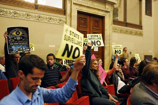 Protestors against the Domain Awareness Center hold up signs during a city council meeting. Photo: Ian C. Bates, The Chronicle