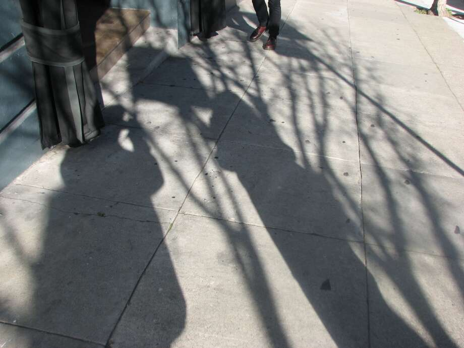 Union Square, March 10, 2013; Two shadows stop and stare Photo: Will Hearst