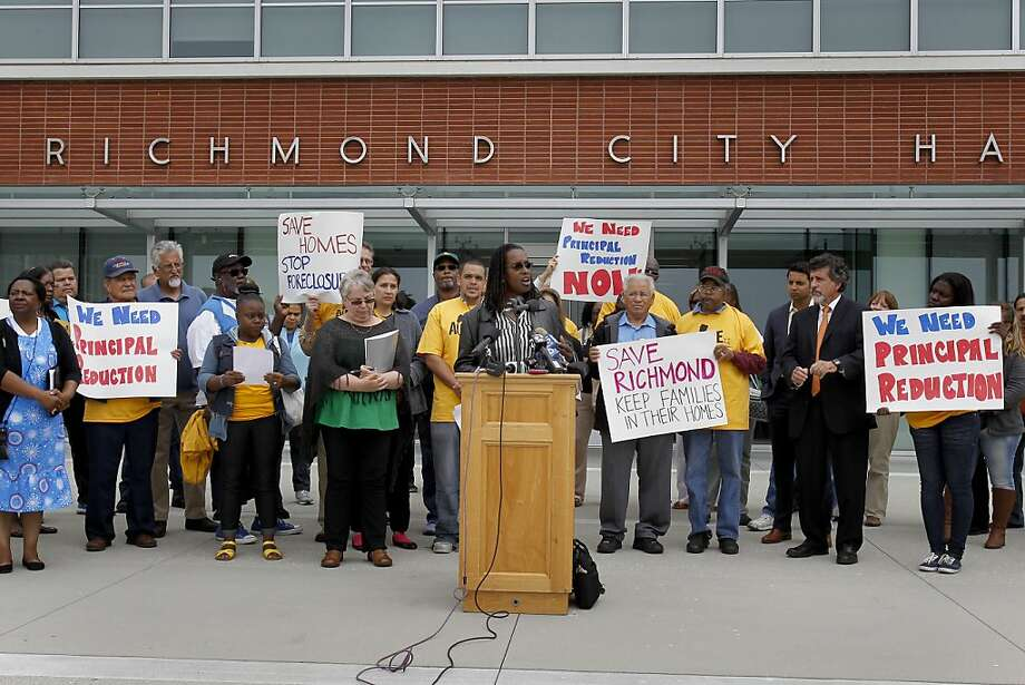 Homeowners and local officials stood on the steps of Richmond City Hall to praise the new plan. Photo: Brant Ward, The Chronicle