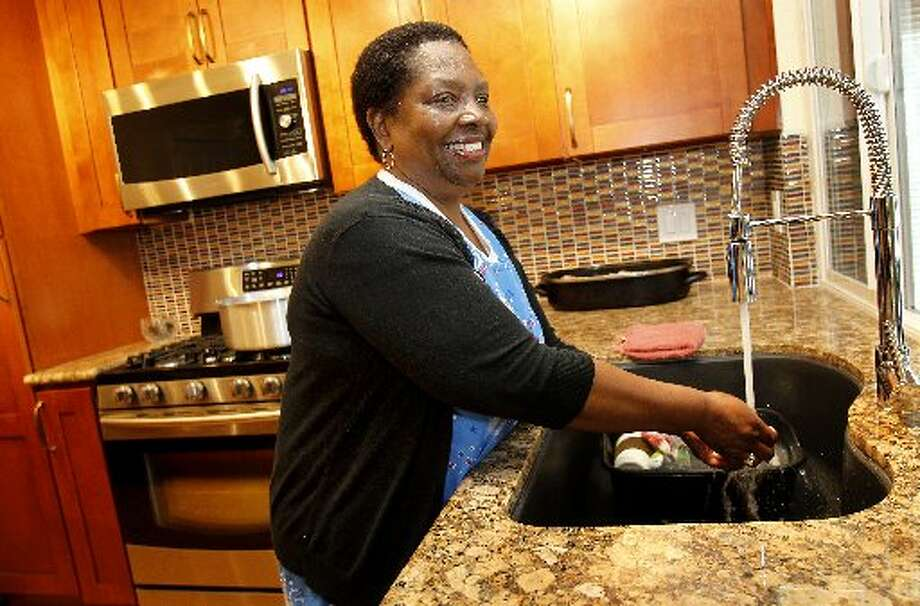 Doris Ducre prepared dinner in her kitchen after giving interviews to several media outlets. Photo: Brant Ward, The Chronicle