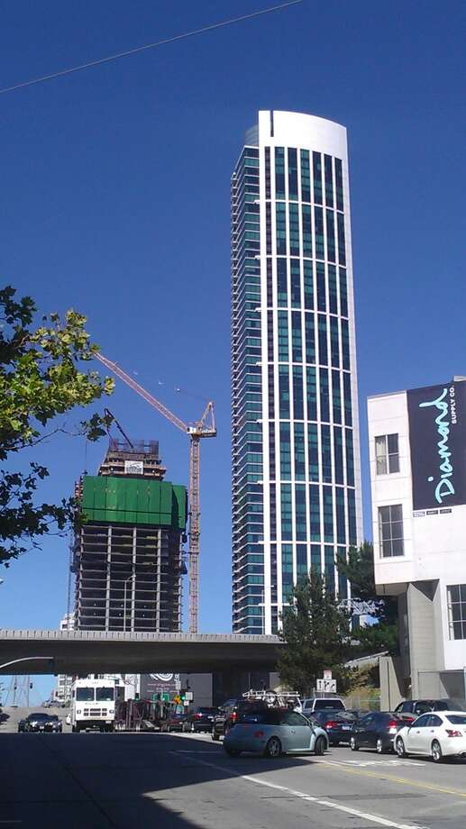 The second phase of One Rincon, a pair of residential towers at First and Harrison streets, will open in the summer of 2014 Photo: John King, The Chronicle