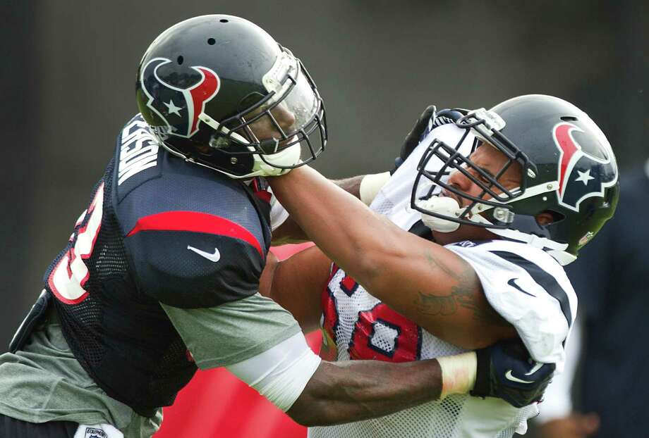 Houston Texans tackle Ryan Harris (68) blocks linebacker Willie Jefferson (63) during Texans training camp at the Methodist Training Center Sunday, July 28, 2013, in Houston.  ( Brett Coomer / Houston Chronicle ) Photo: Brett Coomer, Staff / © 2013 Houston Chronicle