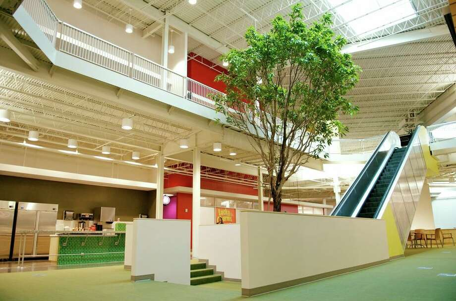 Tech giant Rackspace renovated a mall for their creative space. They maintained some of the aspects of the previous function of the building, for example directories pointing to different parts of the workspace. Photo: Courtesy Photo