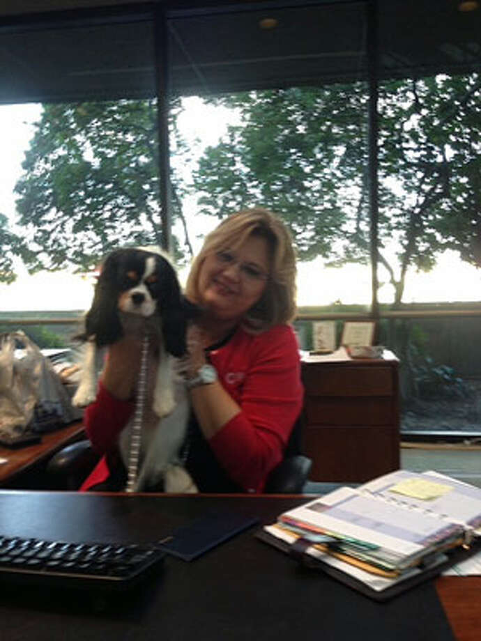 A photo of Willow with her personal banker Sandie Krause on a visit to Frost Bank. Photo: Courtesy Of Suzanne S. Hildebrand