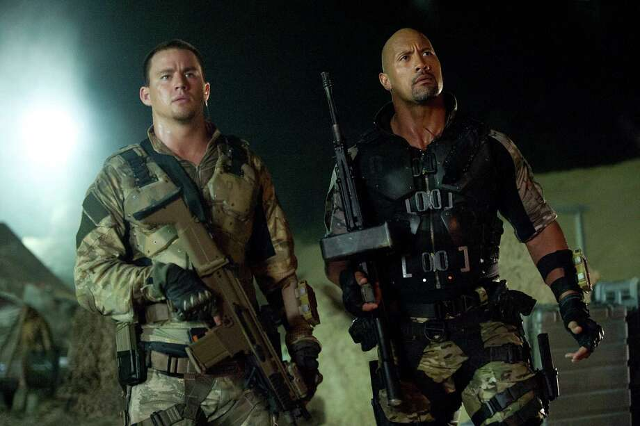 "This film image released by Paramount Pictures shows Channing Tatum, left, and Dwayne Johnson in a scene from ""G.I. Joe: Retaliation."" (AP Photo/Paramount Pictures, Jaimie Trueblood) Photo: Jaimie Trueblood / Paramount Pictures"
