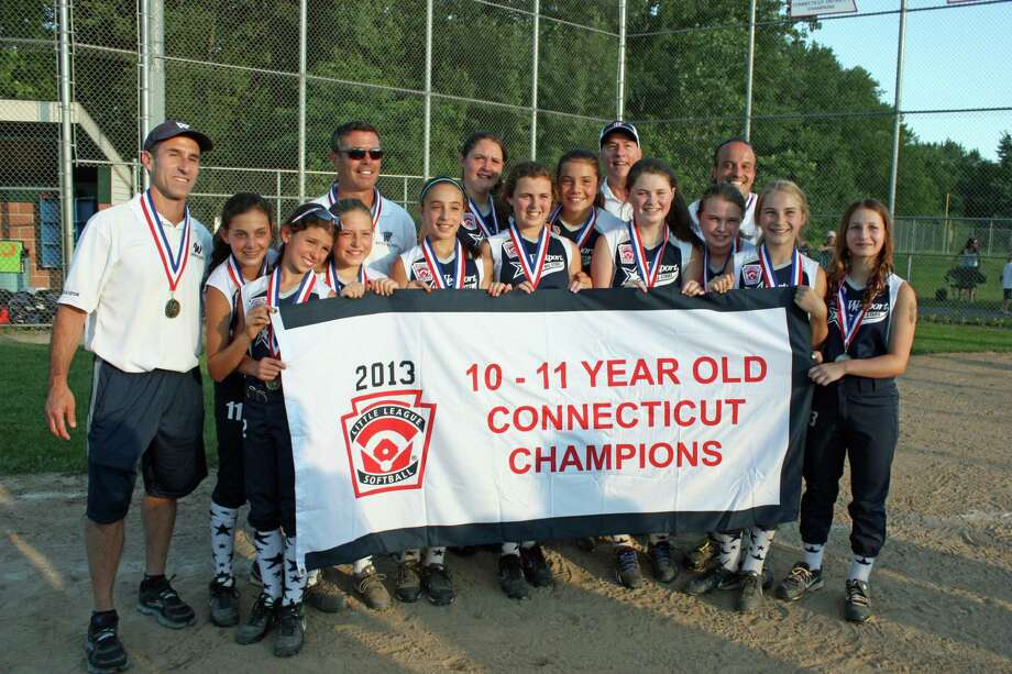 Westport's 10-11 Little League softball team beat Enfield 16-0 in four innings on Tuesday in Newington to win its first state title. Pictured are, from left to right, coach Andrew Klein, Sami Levin, Ali Green, Julia Grimes, manager Mark McWhirter, Sophia Alfero, Maddie McGarry, Erin McWhirter, Natalie Schenck, Westport Little League commissioner Steve Axthelm, Catherine Connell, Madeline Howard, coach Louis Alfero, Erica Fanning and Ellie Klein. Photo: Contributed Photo