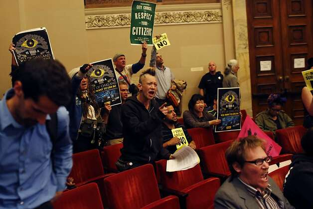 Audience members react after the City Council voted yes to the creation of the Domain Awareness Center during a city council meeting at the Oakland City Hall in Oakland, Calif. on July 30, 2013. Photo: Ian C. Bates, The Chronicle