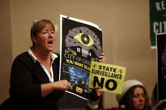 Mindy Stone reacts after the City Council voted yes on the Domain Awareness Center during a city council meeting at the Oakland City Hall in Oakland, Calif. on July 30, 2013. Photo: Ian C. Bates, The Chronicle