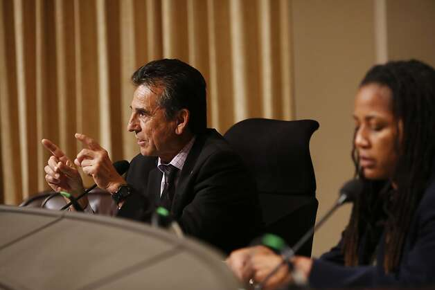 City Council member Noel Gallo talks as audience members yell at him while Council member Lynette Gibson McElhaney looks on during a city council meeting at the Oakland City Hall in Oakland, Calif. on July 30, 2013. Photo: Ian C. Bates, The Chronicle