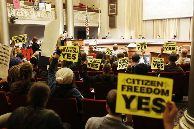 Protestors against the Domain Awareness Center hold up signs during a city council meeting at the Oakland City Hall in Oakland, Calif. on July 30, 2013. Photo: Ian C. Bates, The Chronicle