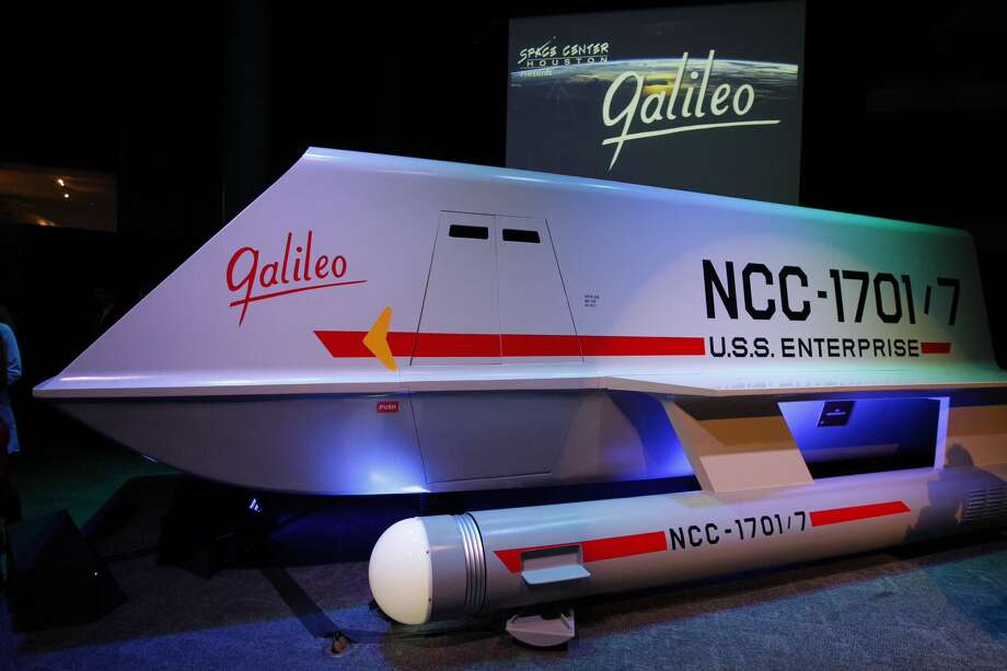 "Officials unveil the fully-restored StarTrek Galileo ship. Officials unveiled the newly restored spaceship prop featured in the 1967 Star Trek episode ""The Galileo Seven"" after a yearlong restoration project led by Adam and Leslie Schneider, die-hard Star Trek fans and memorabilia collectors. The life-size spaceship will be on permanent display inside Space Center Houston's Zero-G Diner and will be one of only a few exhibitions in the world where visitors can see iconic sci-fi history that has influenced generations of innovators. (Cody Duty / Houston Chronicle)"