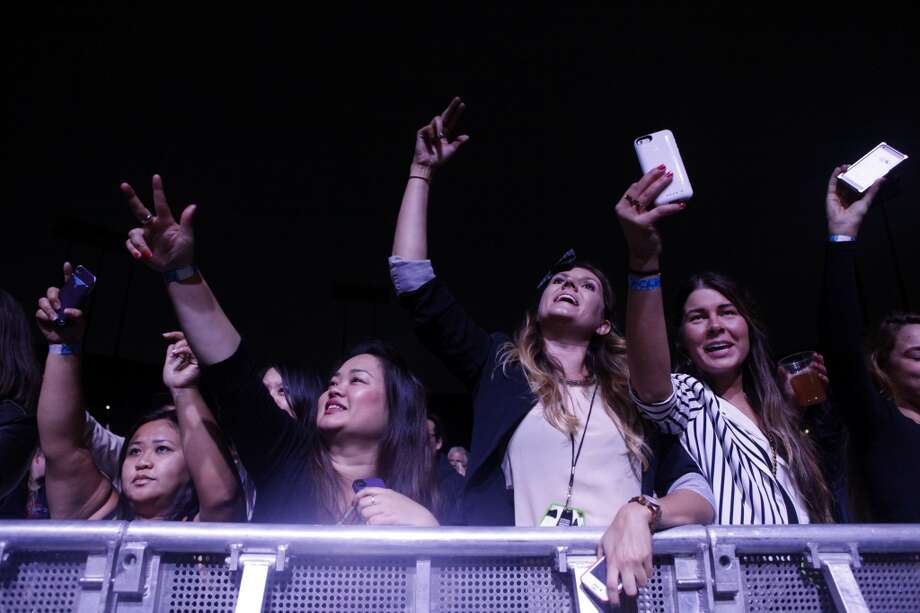 Fans in the front row enjoy Justin Timberlake and JayZ's performance at Candlestick Park in San Francisco, Calif. on July 26, 2013. Photo: Katie Meek, The Chronicle