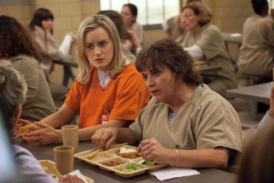 """Orange Is The New Black,"" a new Netflix series starring Taylor Schilling, is based on n the 2010 best-selling memoir of the same name by Piper Kerman. In the book, Kerman chronicles her 13-month imprisonment in Danbury Federal Correctional Institution -- a sentence she faced after being indicted for trafficking drug money for Nora, an international drug smuggler and her onetime lover."