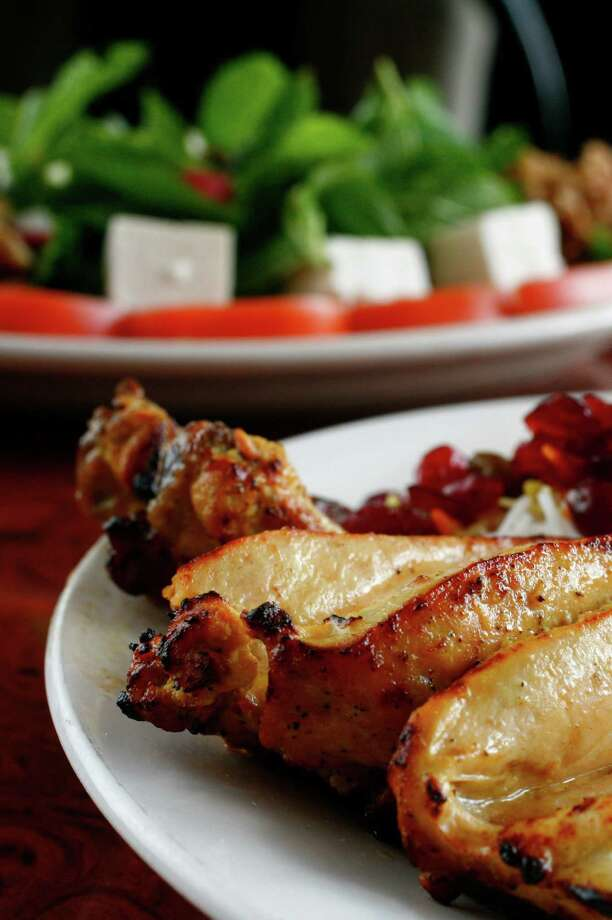 The Jujeh Kabob is a Cornish hen that is cut, marinated, skewered and grilled and served with Sour Cherry Rice. Photo: Michael Paulsen, HC Staff / Houston Chronicle